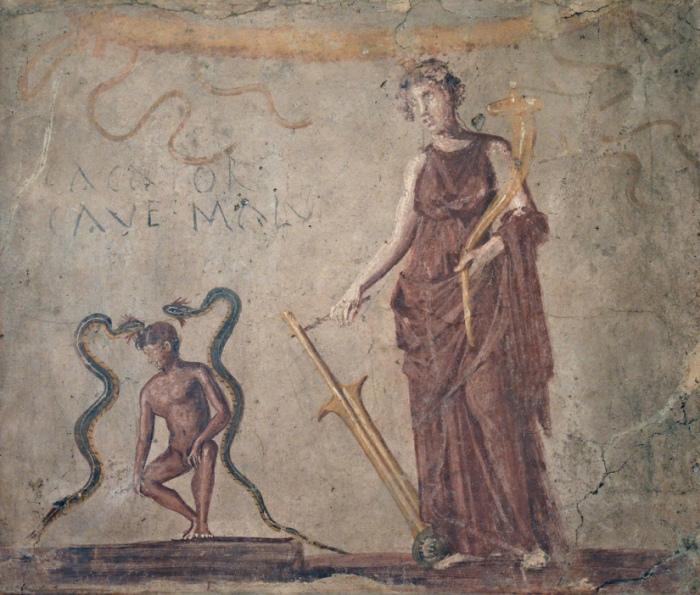 Фреска из коридора, ведущего в латрину, изображает Исиду. Надпись гласит: «Cacator cave malum» – «Какающий, остерегайся зла» (Неаполитанский археологический музей)./Фото: followinghadrian.files.wordpress.com